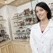Portrait of a happy optometrist in store — Stock Photo