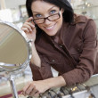 Portrait of a happy beautiful mid adult woman wearing glasses - Stock Photo