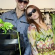 Portrait of a happy young couple with boxes in fashion store — Foto de Stock