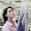 Stock Photo: Beautiful woman looking up in laundry