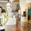 Стоковое фото: Portrait of happy mid adult womstanding with hands on hips in fashion clothing store