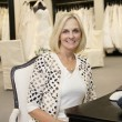 Portrait of happy senior womsitting in bridal store — Stock Photo #21883071