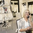 Portrait of happy wommaking call in bridal store — Stock Photo #21883133