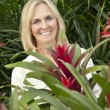 Portrait of a cheerful senior woman in garden center — Stock Photo
