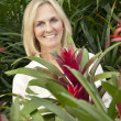 Portrait of a cheerful senior woman in garden center — Stock Photo #21883683