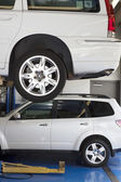 Car on hoist in automobile repair shop — Stock Photo