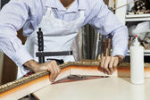 Midsection of a young craftsman working on picture frame's corner — Stock Photo