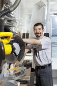 Portrait of a Hispanic employee using circular saw — Stock Photo