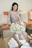 Portrait of a beautiful mid adult woman pampering with pedicure in beauty spa — Foto de Stock