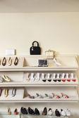 Footwear on display rack in shoe store — Stock Photo