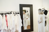 Senior woman looking at herself in mirror — Stockfoto