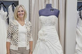 Portrait of a happy senior bridal store owner — Stock Photo