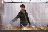 Portrait of a young Asian man cooking at street food stall — Foto Stock