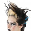 Close-up of gothic woman with face painting and spiked hair over white background — Stock Photo