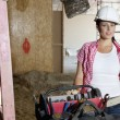 Portrait of young architect wearing hardhat standing with toolbox — Stock Photo