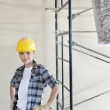 Portrait of mid adult woman standing with hands on hips at construction site — Stock Photo #21890865