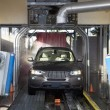 Motor vehicle passing through car wash - Stock Photo