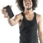 portret młodego mężczyzny szczęśliwy pokazując telefon komórkowy na białym tle — Zdjęcie stockowe
