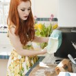 Young redheaded woman in preparation for baking — Stock Photo