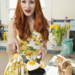 Portrait of a young redheaded woman cooking omelet — Stock Photo #21896651