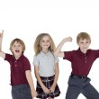 Portrait of cheerful school children over white background — Stock Photo #21897047