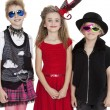 Portrait of school children wearing fancy dress outfits over white background - Stock Photo