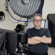 Portrait of a technician with arms crossed standing in photographer's studio — Stock Photo