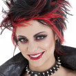 Stock Photo: Portrait of beautiful young punk womwith spiked hair