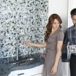 Young couple looking at color samples together in contemporary kitchen — Stock Photo