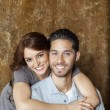 Stock Photo: Portrait of happy young woman hugging man from behind