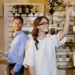 Happy young couple browsing for fixtures in lights store — Stock Photo
