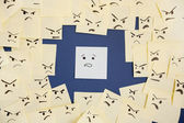 Sticky notes with anthropomorphic face blaming colleague — Stock Photo