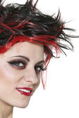 Close-up of beautiful punk woman smiling over white background — Stock Photo