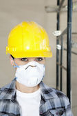 Portrait of woman worker wearing dust mask at construction site — Stock Photo