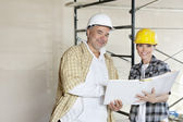 Portrait of happy team of architect with paper documents at construction site — Stock Photo