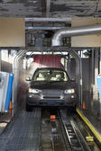 Motor vehicle passing through car wash — Stock Photo