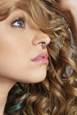 Close-up of beautiful blond woman with pierced nose looking away — Stock Photo