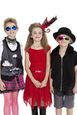 Portrait of school children wearing fancy dress outfits over white background — Stock Photo