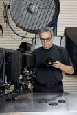 Front view of a technician in photographer's studio — Stock Photo