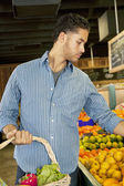 Handsome young man shopping in market — Stock Photo