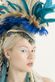 Close-up of beautiful young woman with headdress — Stock Photo