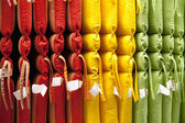 Multicolored cushions arranged in store — Stock Photo