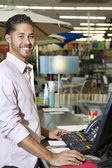 Portrait of a happy store clerk in shop — Stock Photo
