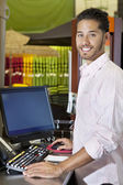 Portrait of a happy salesperson in store — Stock Photo