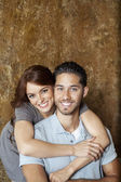Portrait of happy young woman hugging man from behind — Stock Photo