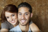 Close-up of beautiful young woman hugging man from behind — Stock Photo