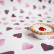 Close-up of cupcake over heart shaped background — Stockfoto