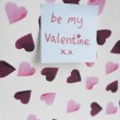 Close-up of sticky note with a orthographic message over heart shaped background — Stock Photo #21900095