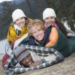 Group Of Friends Lie In Sleeping Bags - Stock Photo