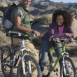 Royalty-Free Stock Photo: Couple With Mountain Bikes